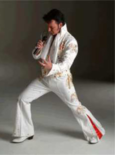 Mike as Elvis in white costume
